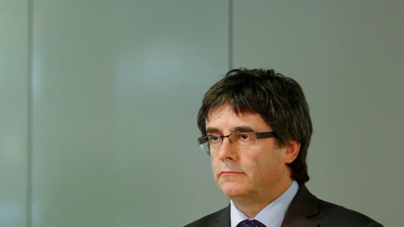 Former regional leader of Catalonia Puigdemont attends a news conference in Berlin